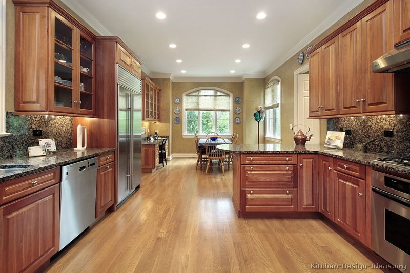Kitchen Design Ideas For Medium Kitchens baltic brown granite countertop with medium wood cherry cabinets