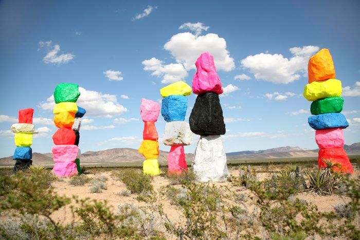14 Bizarre Roadside Attractions In Nevada That Will Make You Do A Double Take Seven Magic Mountains Road Trip Usa Las Vegas Trip
