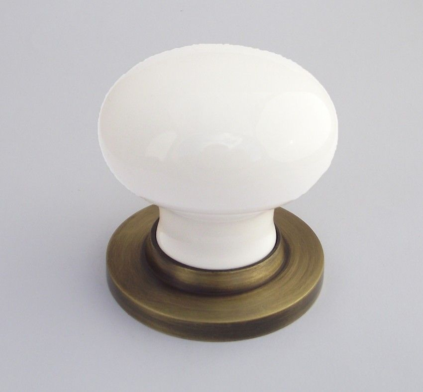 BUL602ABBUL33WHI White Porcelain Door Knob On Antique Brass Rose