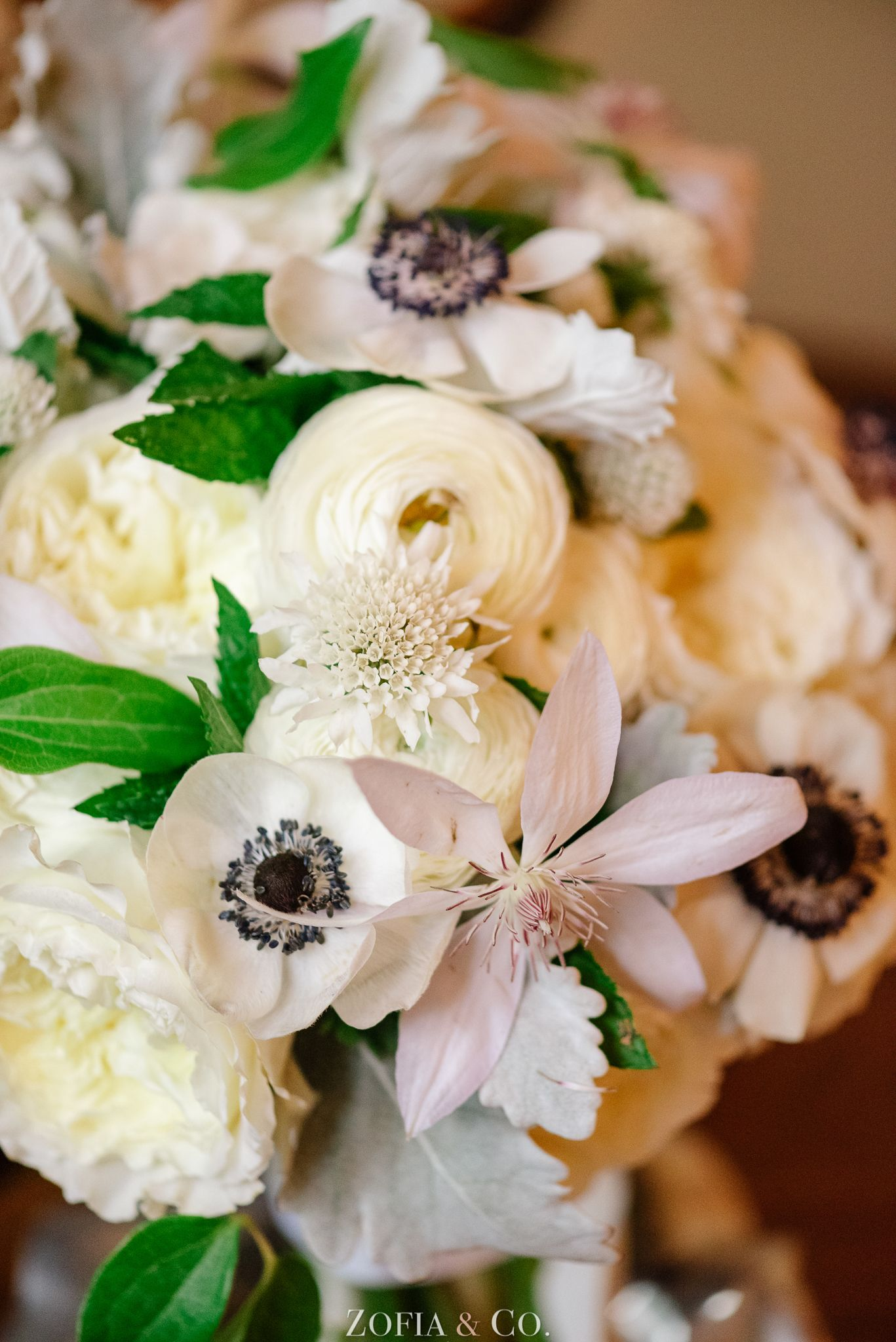 A rainy day creates an intimate wedding wedding bouquets ranunculus and anemone wedding bouquet photography zofia co izmirmasajfo
