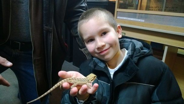 Matthew is pretty darn happy with his new bearded dragon from The Animal Store.