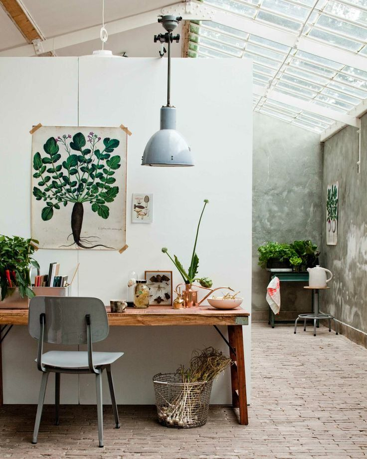 Rustic home office with iron chair and industrial style pendant.