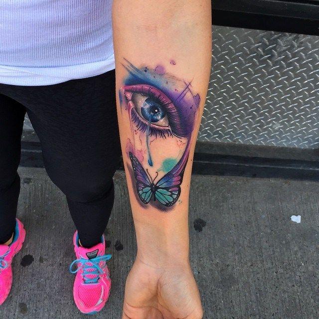 Watercolor Eye Tattoo By Frankie Oneshot Butterflytattoo Eyetattoo Watercolortattoo Forearm Tattoos Bullseye Tattoo Tattoos