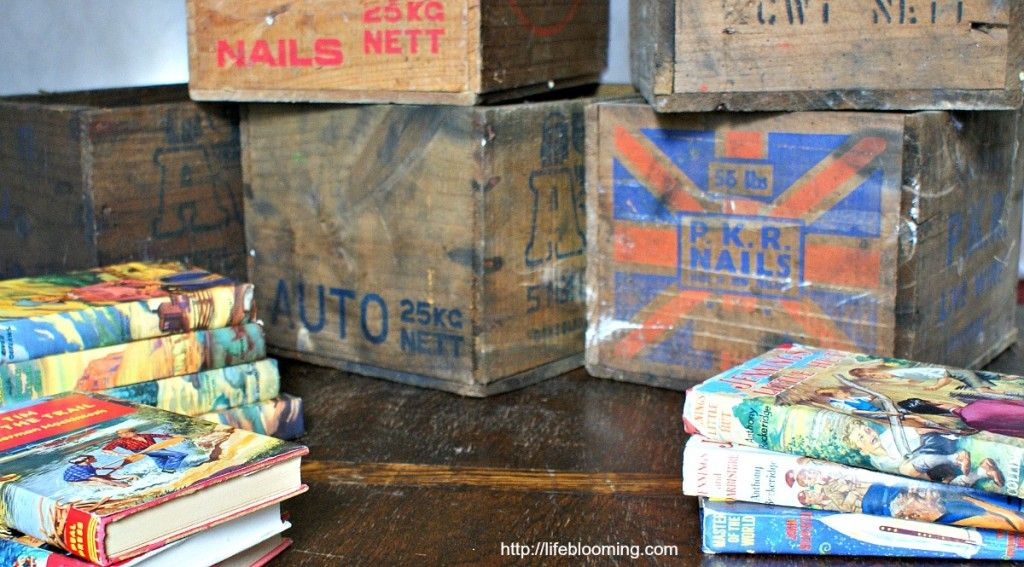Vintage wooden crates and vintage children's books.  Preparing for a photo shoot as part of the Easy Cheats for Way Cooler Photos series at ...