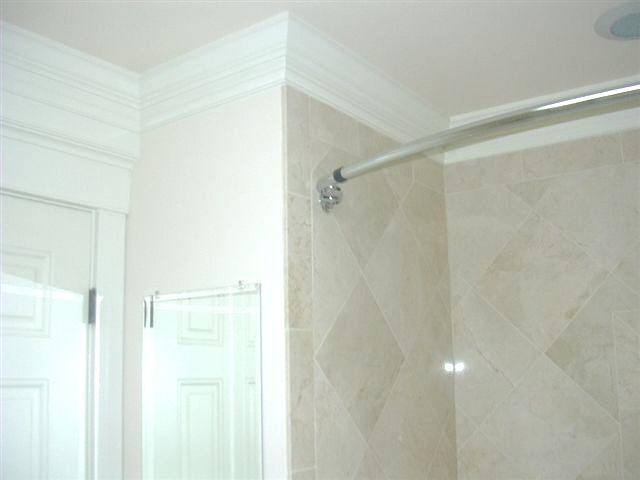 Tile Around Bathtub up to crown molding at bathroom