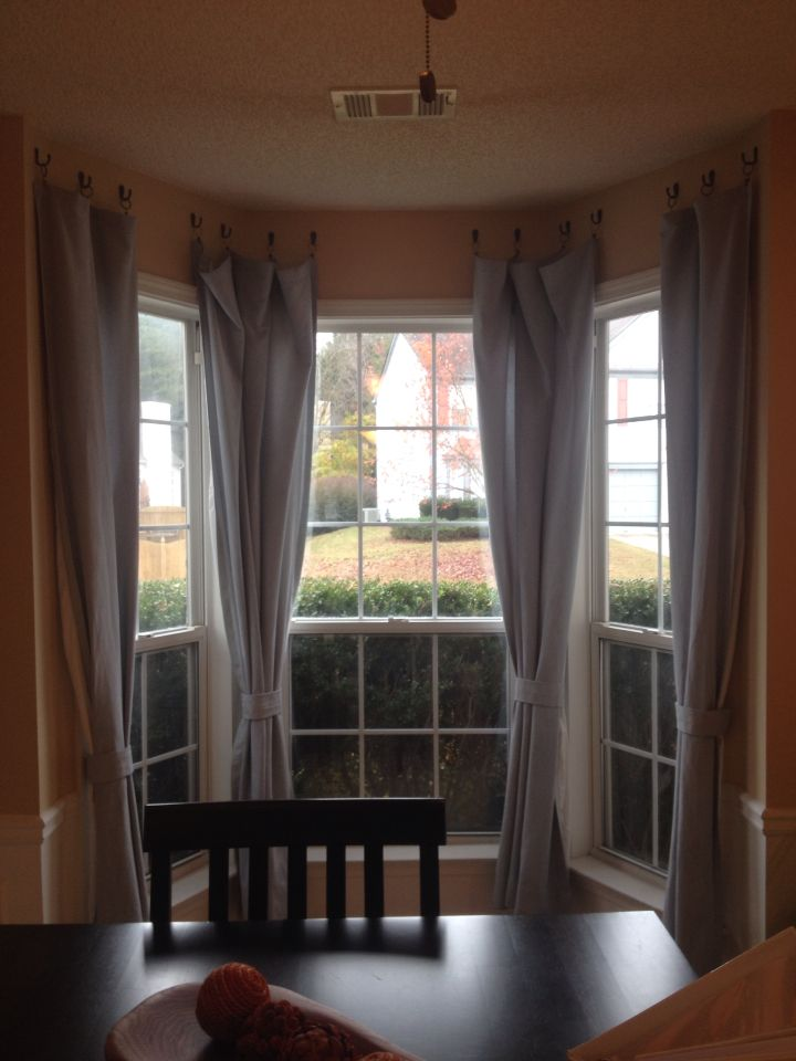Great Idea To Hang Curtains In A Bay Window Without Expensive Curtain Rods Decorating Small Spaces Bedroom Hanging Curtains Curtains Without Holes