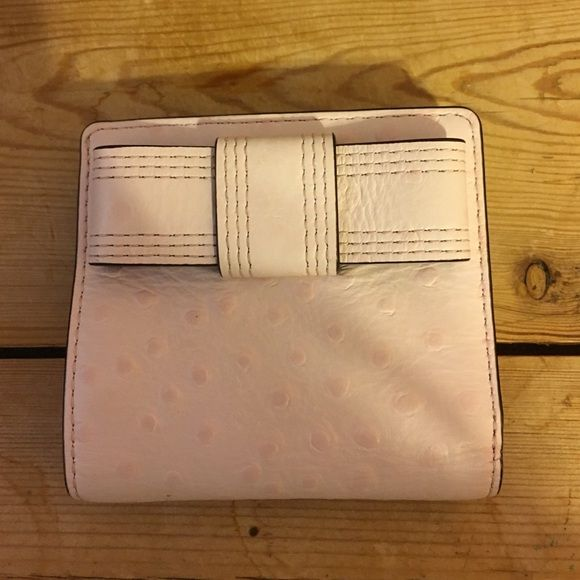 Kate Spade Serenade Valencia Road Small Bow Wallet Kate Spade Serenade Valencia Small Bow Wallet. Ostrich embossed, light pink. Used everyday for 2 weeks. In excellent condition. kate spade Bags Wallets