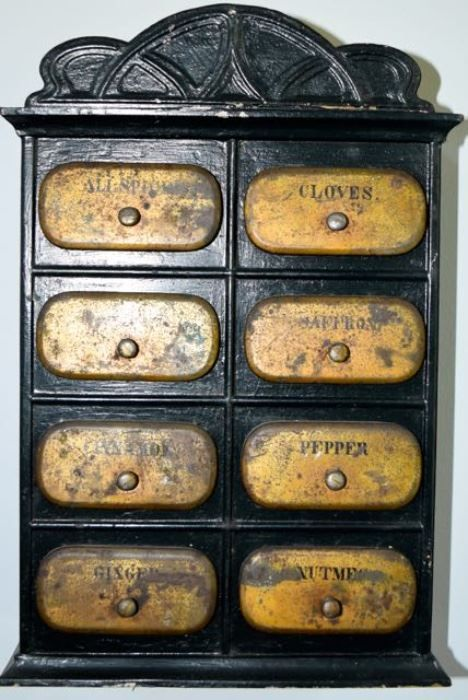 Found on EstateSales.NET: Early metal spice cabinet with original paint