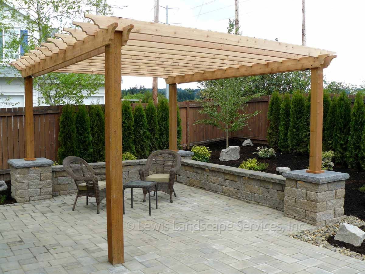 cozy outdoor living room patio pergola with two classic chairs and small table landscape picture and gray brick natural open living room des