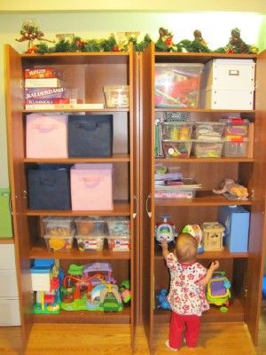 A Old Pantry Transformed Into Toy Storage Cabniet That You Can Put Child Saftey Locks
