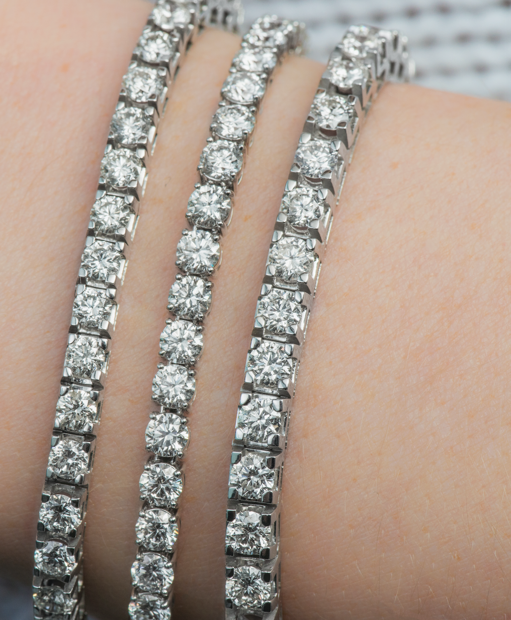 A Stack Of Diamond Tennis Bracelets Is The Perfect Go To Accessory For Any Occasion Stop B Sparkly Bracelets Diamond Jewelry Store White Gold Diamond Bracelet