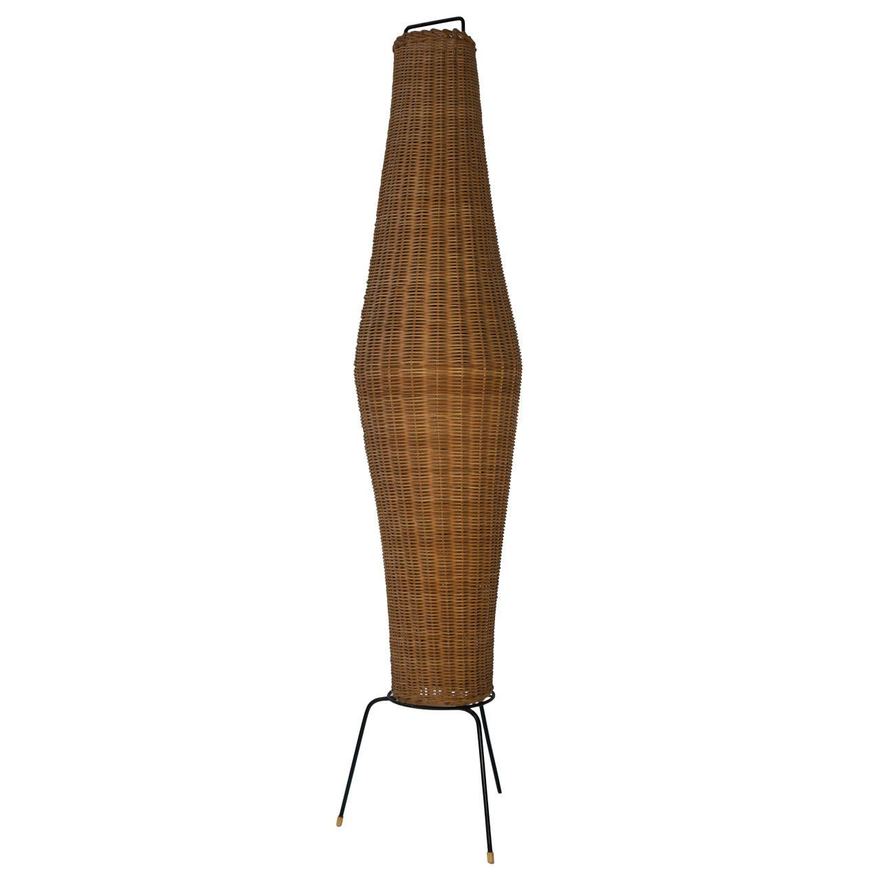 Wrought iron tripod base fishing basket floor lamp in the style of wrought iron tripod base fishing basket floor lamp in the style of tony paul from geotapseo Images