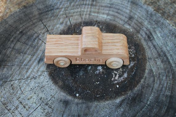May be personalized with name up to 8 letters. Please add name with correct spelling on checkout. Made from oak 1.75 tall 5 long 1.5 wide Finished with shellac Wooden wheels are glued on securely and rolls freely