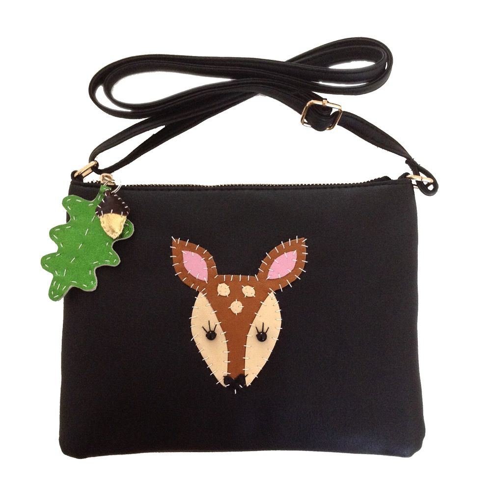 * Oh my deer! This is one super cute little handbag!* Black vinyl handbag* Leather deer applique * Beady black glass eyes* Metallic green leather oak leaf and acorn keyring on zip pull* Top zip fastening * Zipped interior pocket* Long adjustable strap* Measures approximately 23cm x 17cm * This is a limited edition customised handbag