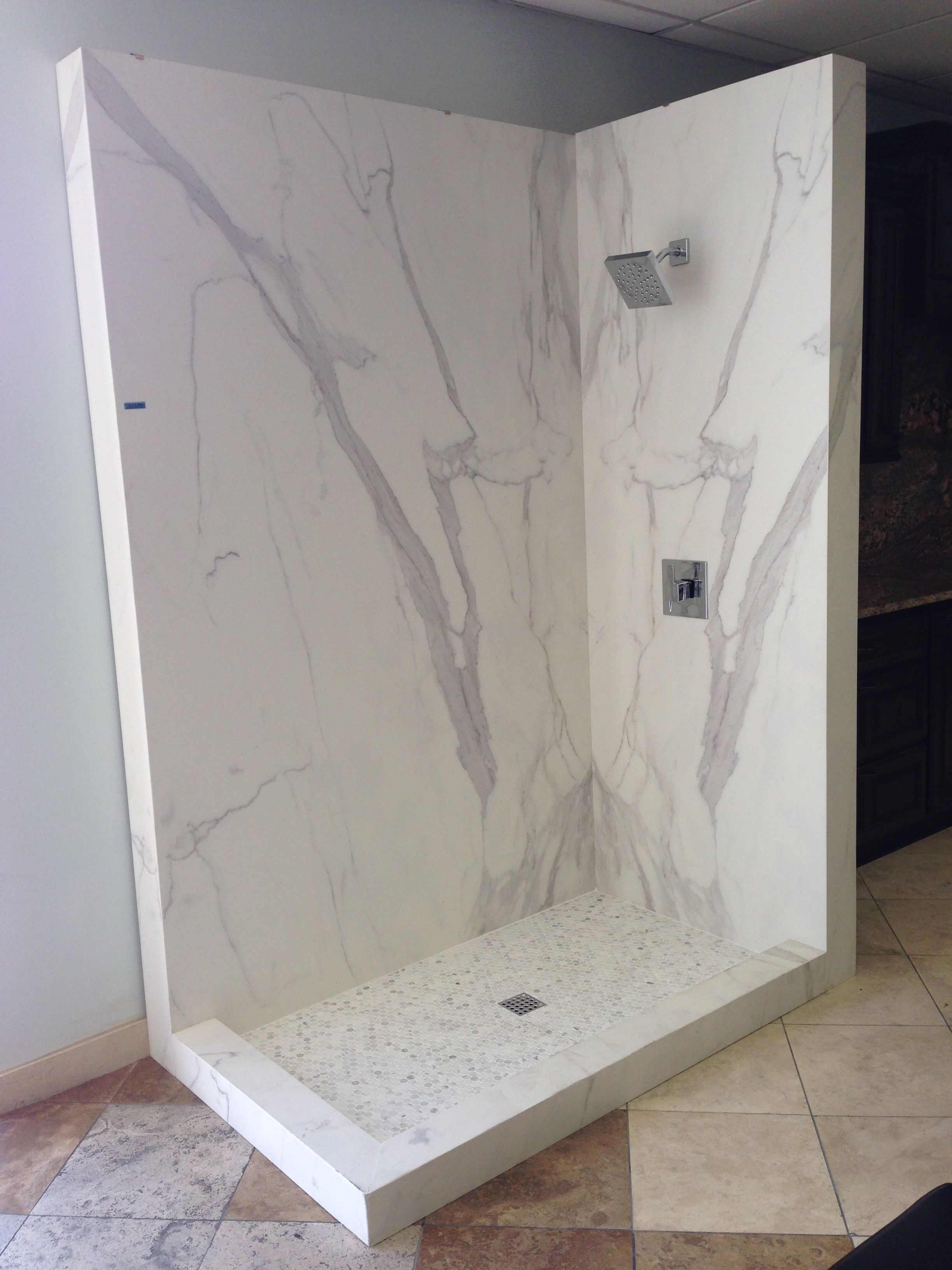 Neolith Estatuario 05 book matched shower in our Austin showroom ...