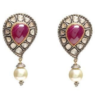 antique kundan work earing with pearl at the bottom..