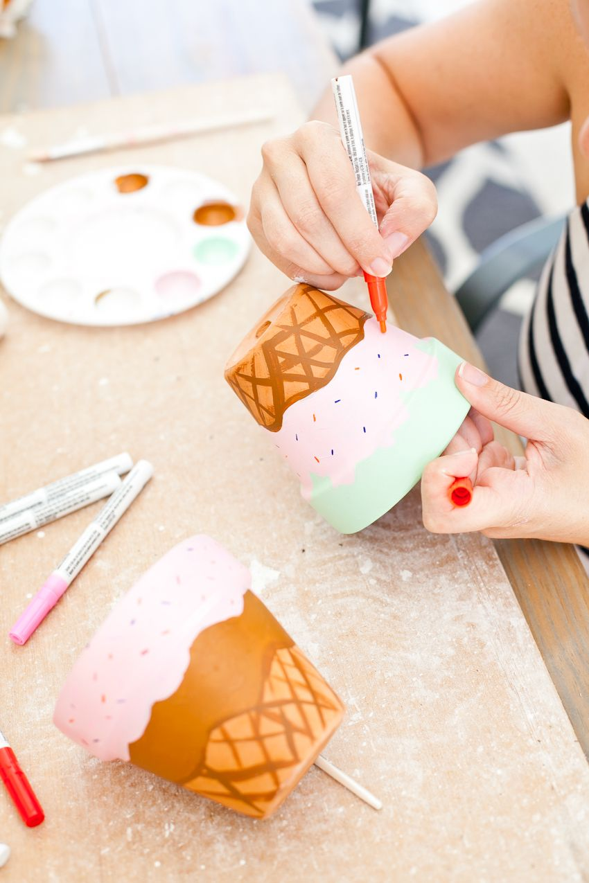 These Painted Waffle Cone Ice Cream Flower Pots will totally satisfy that DIY sweet tooth... and they don't take long to craft either! Perfect for an ice cream party, summer decor, ice cream social and more. - Waffle Cone Ice Cream Painted Flower Pots featured by popular Florida lifestyle blogger Fresh Mommy Blog