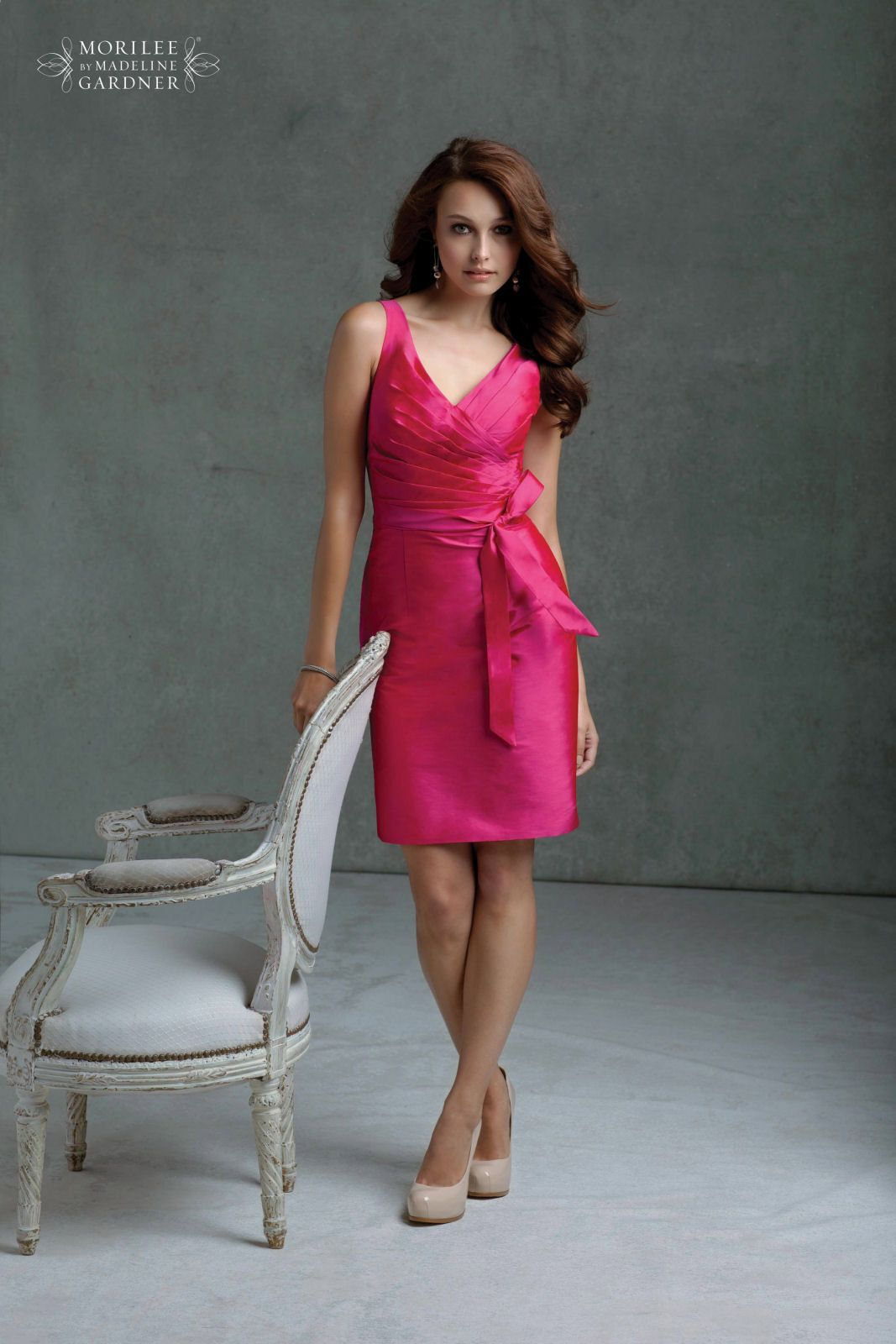 We love this kneelength pink bridesmaid dress with a crossover