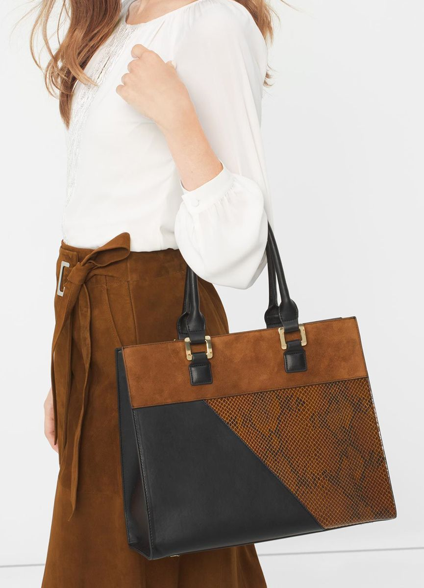 Colorblocking at its finest. Accented by gilded hardware, this tote features sumptuous suede, sleek black and snakeskin-embossed panels. Plus, it is perfectly sized to carry all your essentials. | White House Black Market