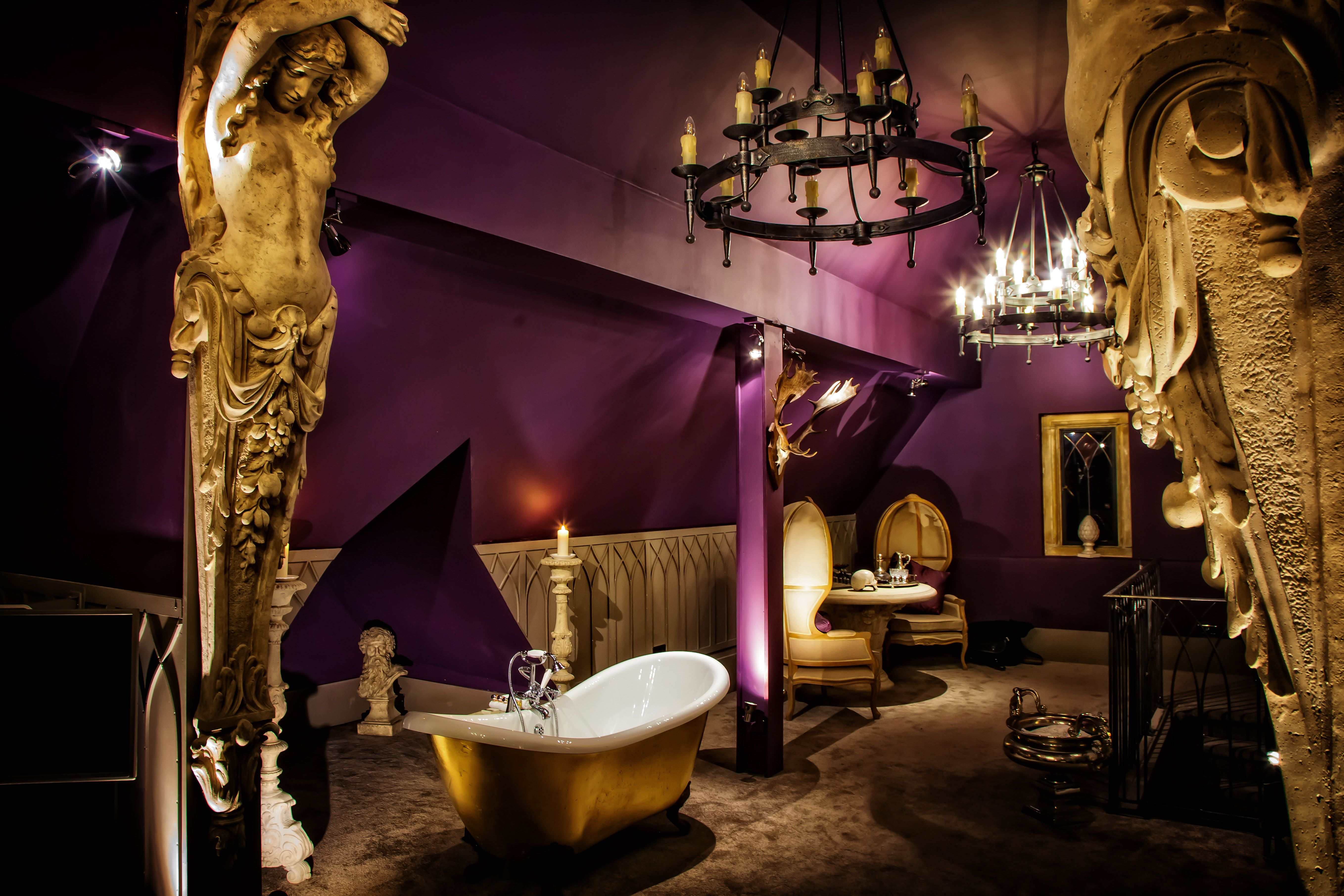 This is a Gothic themed suite in a hotel called 'Manor Court'. This is perfect for tourists that would like a new experience and want to try something different to what they would normally opt for. This hotel is extraordinary because it's not the typical 'British' accommodation as, it's Gothic themed. Some of the amenities include: a draped bed, a chandelier and a golden leaf bath. This serviced hotel also offers: a spa and room service.