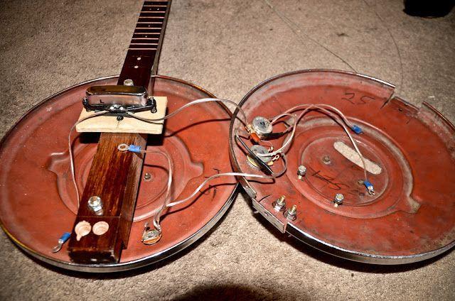 Hubcap guitar build #guitarbuilding Hubcap guitar build #guitarbuilding