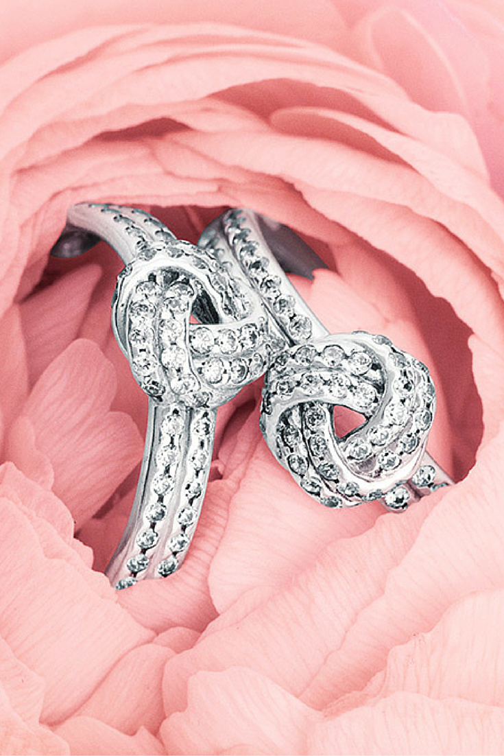 Our Love Knot rings nestled in luscious blooms perfectly encapsulate ...