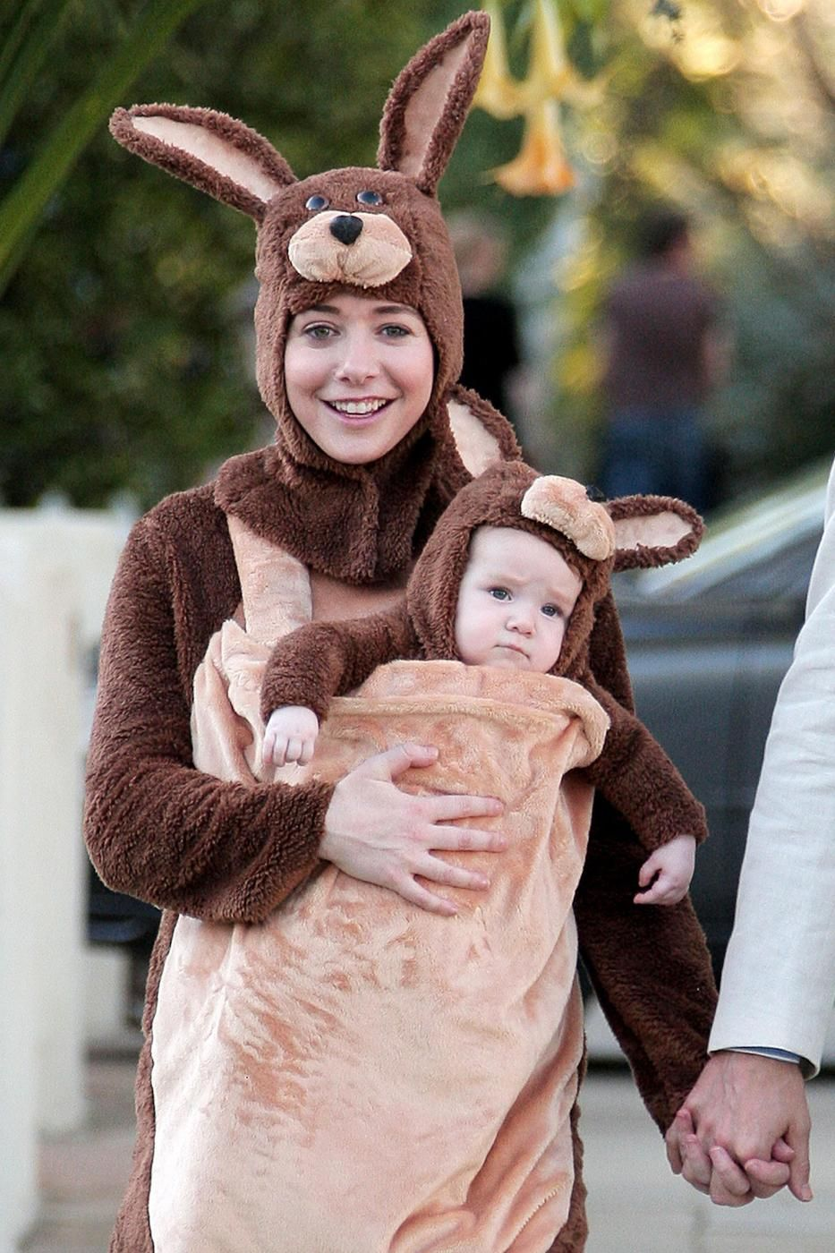 e1663d527d17 Alyson Hannigan wore her - then young - daughter Satyana as a baby kangaroo.