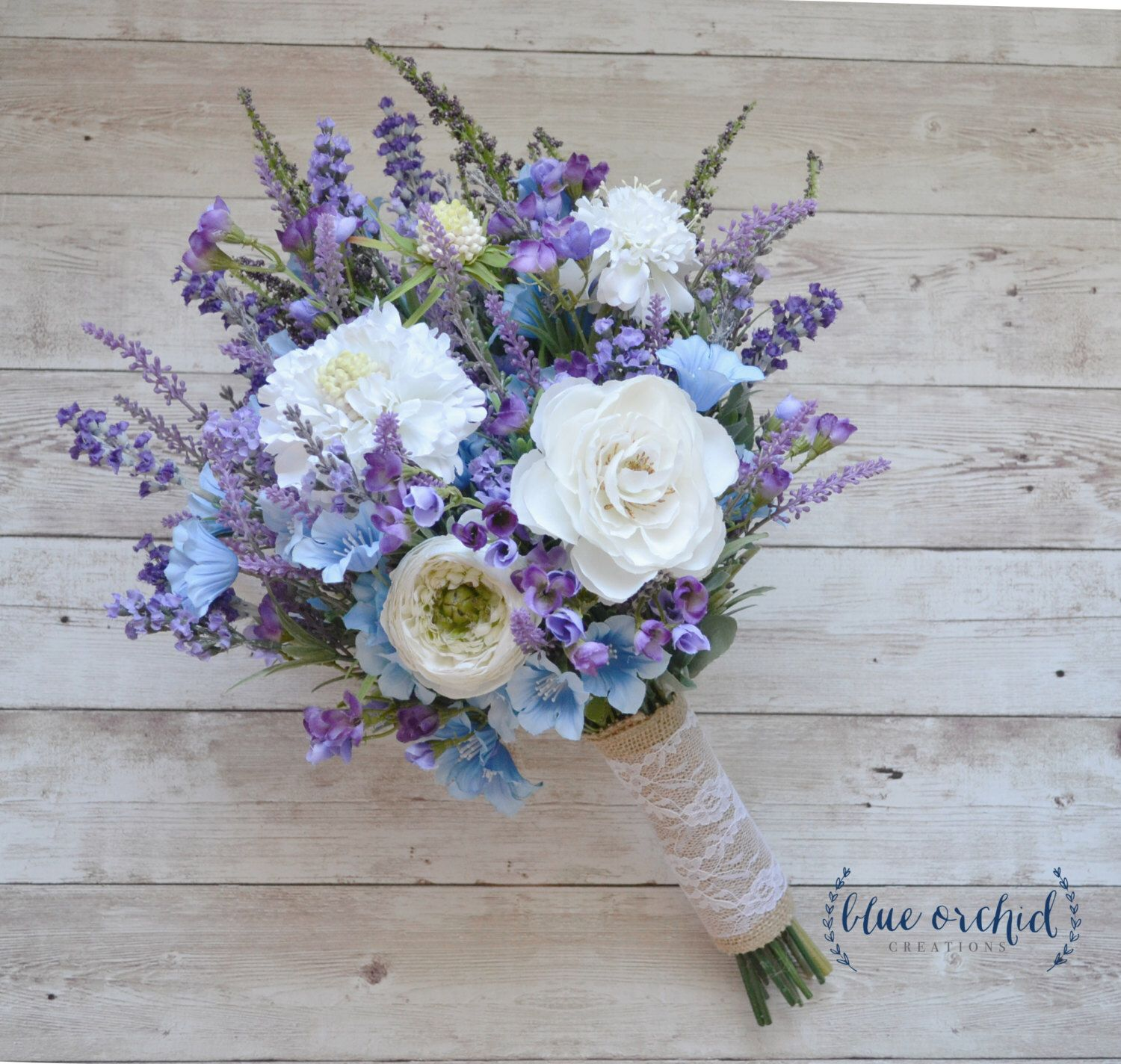 Rustic Wedding Bouquet Blue And Lavender Wildflower Bouquet With Cream Ranunculus And Thistle B Blaue Hochzeitsstrausse Hochzeitsgestecke Blumenstrauss Hochzeit