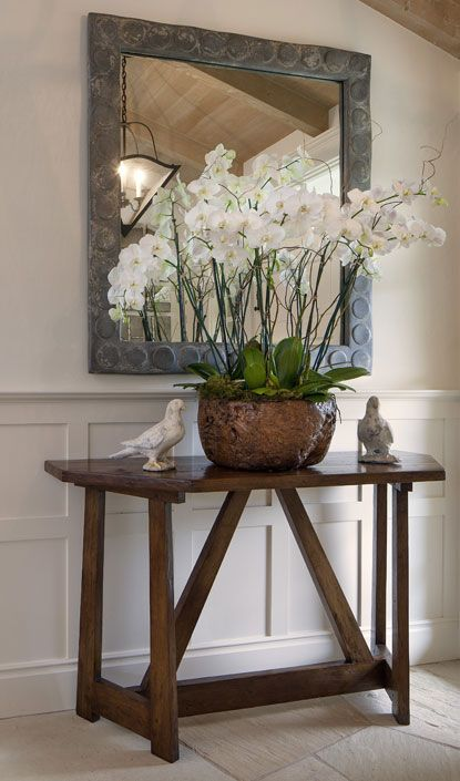 Foyer Table Floral Arrangements : Orchids planted in large metal bucket tablescapes and