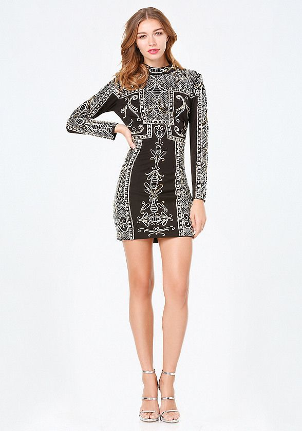 Time to shine. Stunning mock-neck dress lavishly encrusted with shimmering beads and sequins. Shoulder pads create a commanding look. Back hook-and-eye and exposed zip closure. Partially lined.