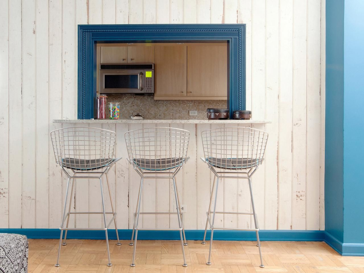Vintage Metal Barstools Sit In Front A Pass Through From The Living Room To Kitchen