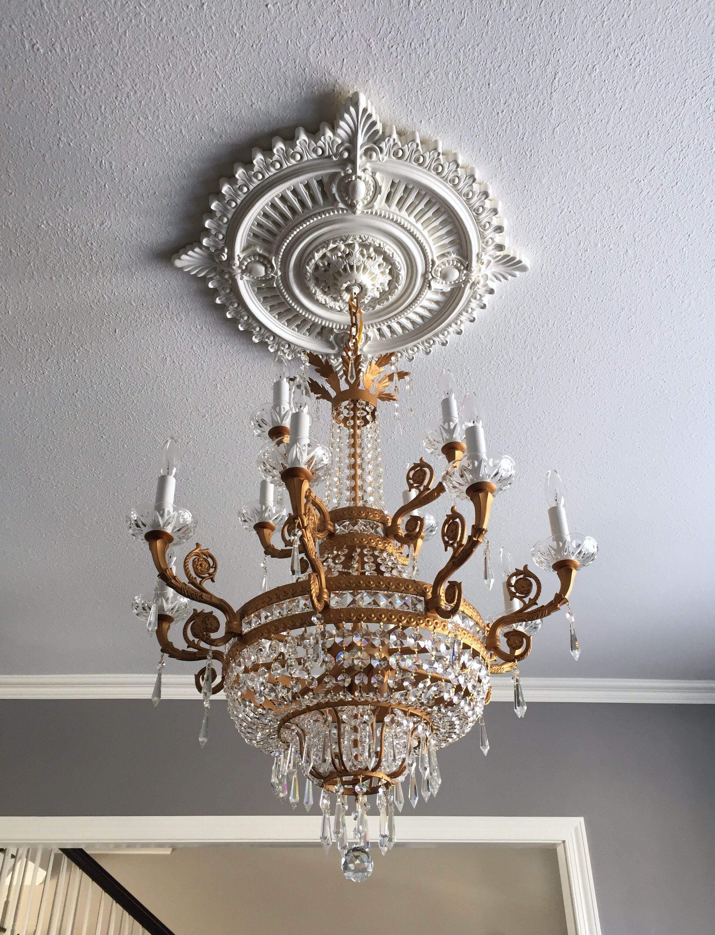 Brassy bronze crystal empire chandelier and ceiling medallion in a