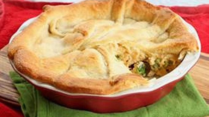 Cheesy chicken, broccoli, and rice is topped with crescent rolls and baked. Uses Green Giant Vegetable Steamers.