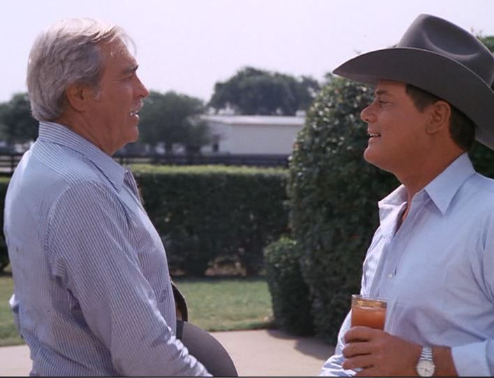 HOWARD KEEL (Clayton Farlow) and LARRY HAGMAN (J R  Ewing) in