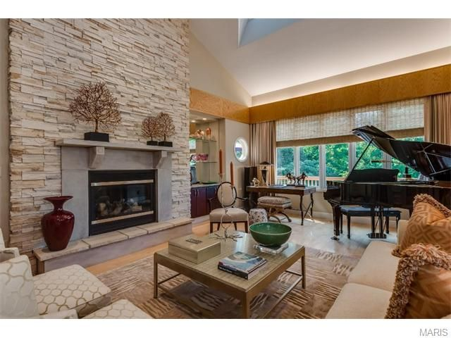 Such interesting detail in the fireplace. The stone work is so elegant. 1508 Sommet Place, Saint Louis, MO.