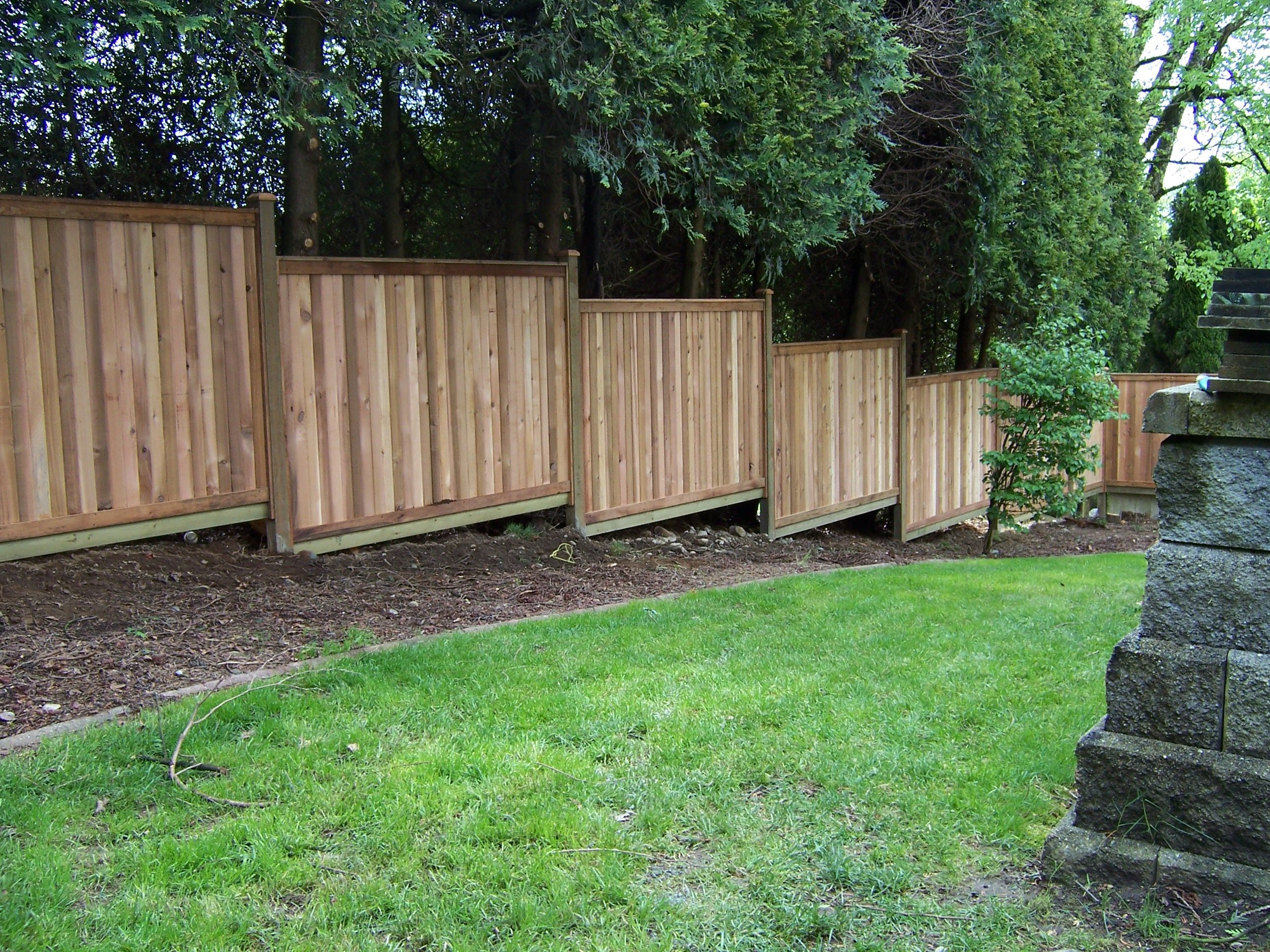 Building A Fence On Sloped Ground Sloped Yard Fence