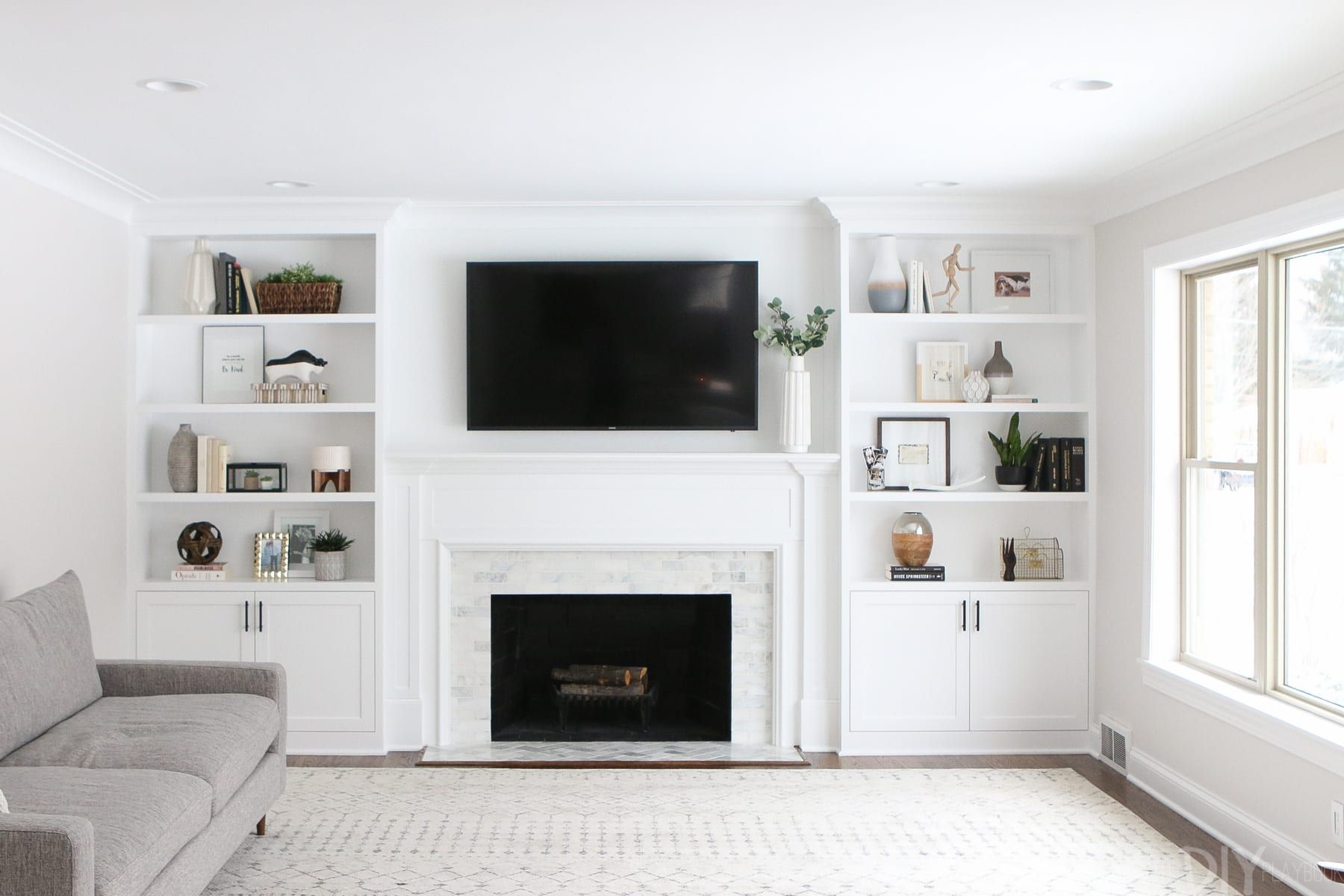 The Dos and Don'ts of Decorating BuiltIn Shelves - Built in shelves living room, Living room built ins, Built in around fireplace, Living room remodel, Living room with fireplace, Fireplace built ins - We often get asked about the  formula  we use for decorating our builtin shelves  The answer is that we don't have a secret method but we do have a few guidelines that we use to decorate builtin shelves and just about any shelf space in our homes  Here are our tips!