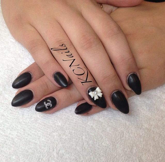 Keep it Classy. Solid matte black almond shaped acrylic nails. White ...