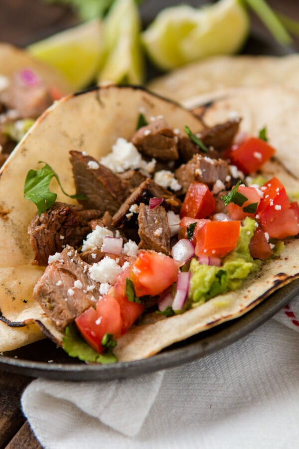 Marinated flank steak makes these authentic carne asada tacos the best we've ever had. Who needs a restaurant or vacation now?! #asadatacos