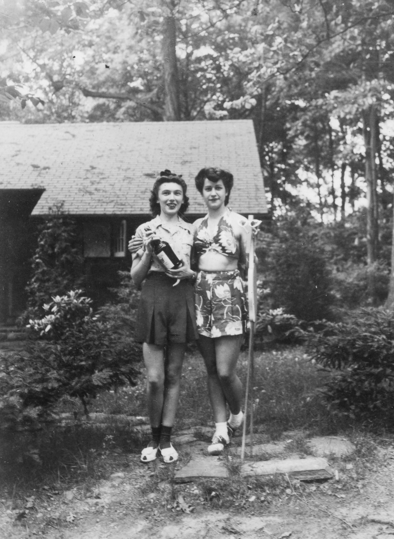 My grandma at age 21 (left) on a retreat holding a bottle of booze, c.1942