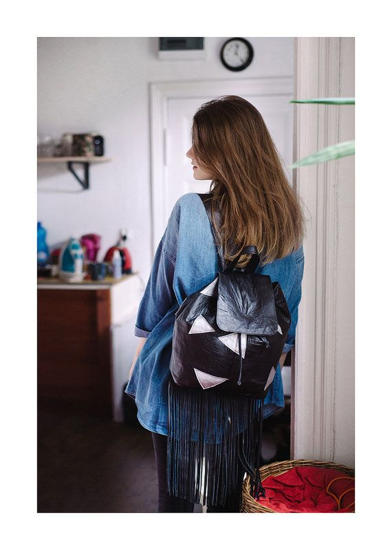 Backpack made from upcycled leather. The main color is black with handmade painted silver triangles.  Height of the backpack: 34cm Width backpack: 38cm #leatherbackpack #urchynn #leatherbackpackfringe