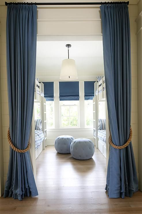 Blue Curtains With Rope Tie Backs Open To A Bunk Room Filled With