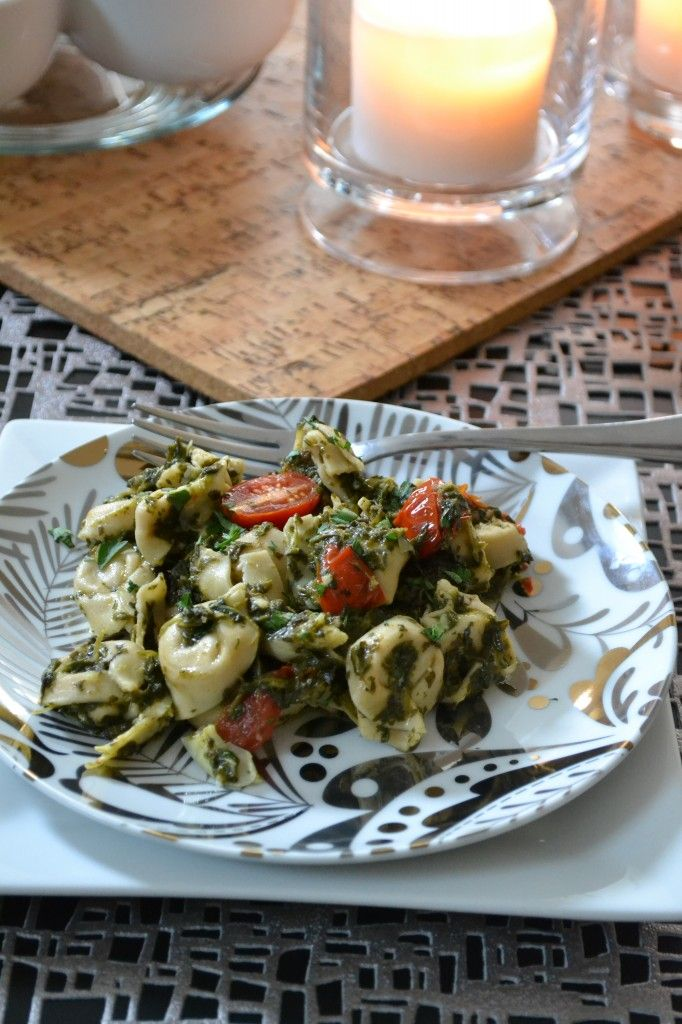 Spinach Pesto Tortellini 1 Box of Butoni Tontellini 1 Small Jar of Marinated Artichoke Hearts, drained 1 Box of Frozen Spinach* ½ a Pint of Cherry Tomatoes cut in half 1 Clove of Garlic Zest and Juice of a Lemon 1 TSP Salt 1 TSP Pepper 1 TBSP Grated Parmesan Cheese 2 TBSP Olive Oil