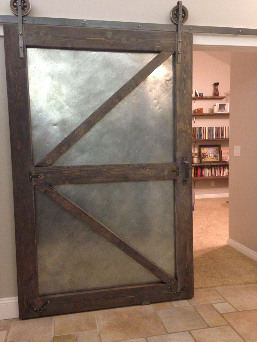 Industrial sliding barn door using aged sheet metal and for Metal barn doors