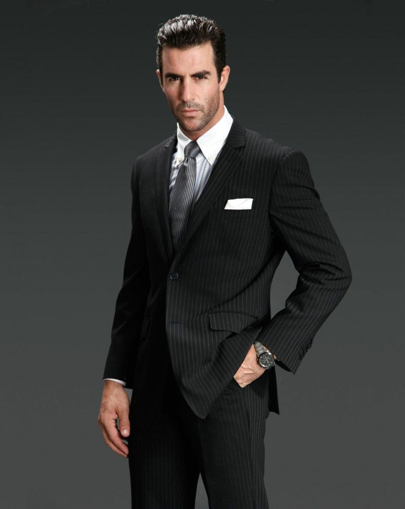 For conservative professional environments, a pinstripe suit or ...