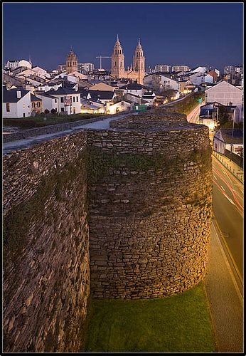 Lugo City Walls, Spain - Located in northwestern Spain, Lugo is the only city in Europe to be surrounded by completely intact Roman walls. The walls reach a height of 10 to 15 meters (30-50 feet) along a circuit ringed with 71 towers. The walk along the top is continuous round the circuit, and features ten gates. Learn more: http://www.touristeye.com/Archaeological-treasures-in-Spain-g-177213