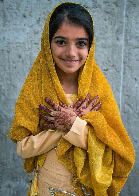 Little girl with henna on her hands makes a pretty picture