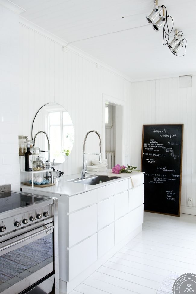 big leaning chalkboard - if you can\'t commit to painting the wall ...