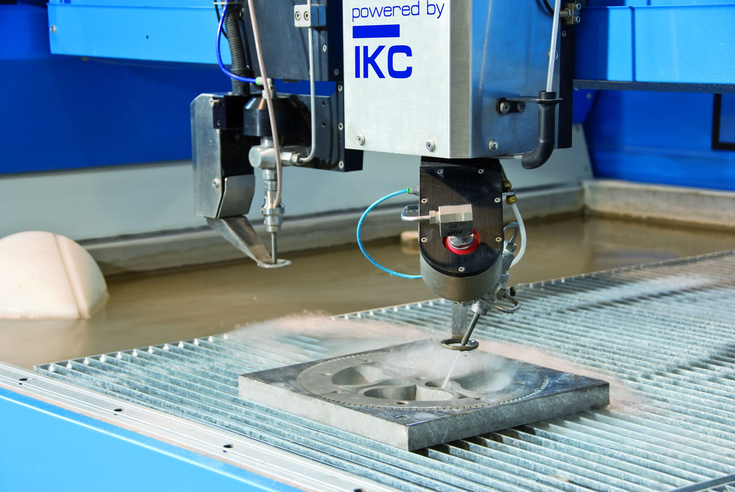 a water jet cutter, uses high pressure water to cut | CNC in