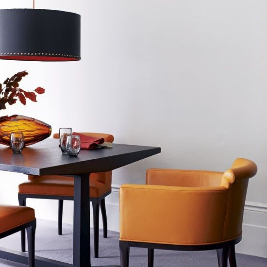 love the shape of this table edge with the low chairs really low